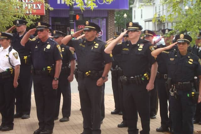 Officers of the Norwalk Police Department salute in honor of those who have died in the line of duty. To celebrate the week of May 15 as National Police Week, the Norwalk Police Department is hosting a Police Memorial Service on Wednesday, May 18.