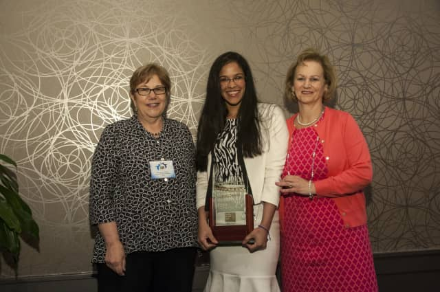Wendy Caceres, center, was honored by Hudson Health Plan.