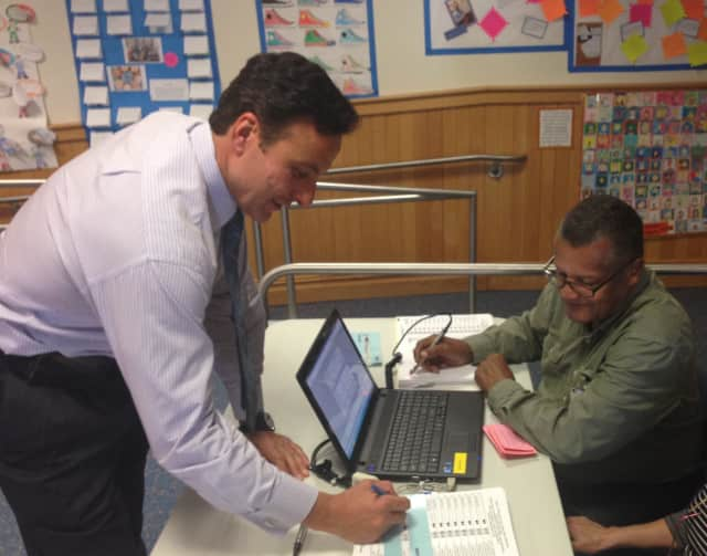 Joseph Vozza votes at Mamaroneck Avenue Sschool Tuesday, where Sid Albert, former village trustee, worked.