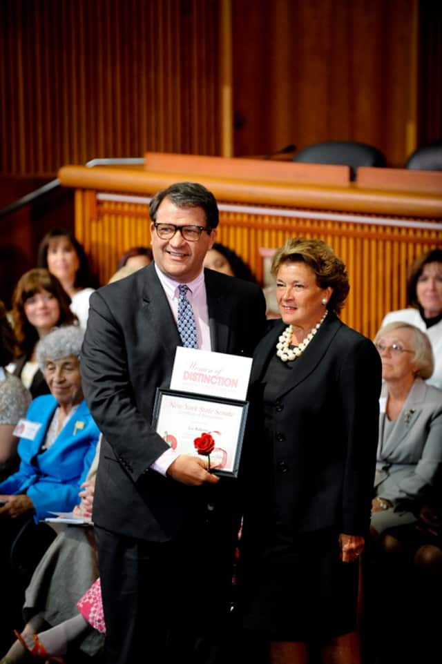 Former Bedford Supervisor Lee Roberts, right, was recently named the 2014 New York State Senate Woman of Distinction. State Sen. George Latimer, left, selected Roberts.