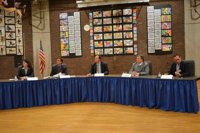 Andrew Bracco, second from left, Eric Karle, center, and Edward Reder, right, won Bedford school board seats. The candidates are pictured at a recent forum.