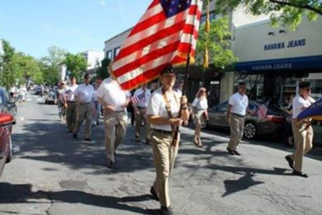 Pictured carrying the flag is Rye resident and Vietnam veteran Fred de Barros.