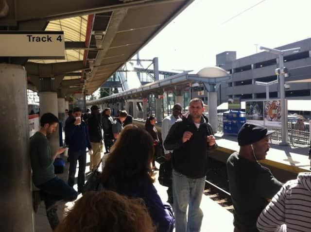 A crowd of commuters waits for a train at the Stamford Train Station last year.