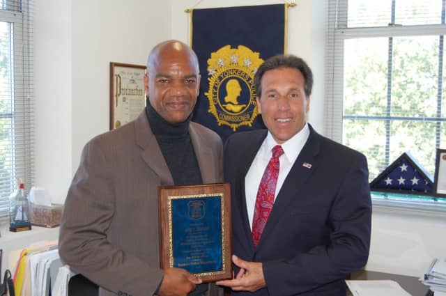 Police Commissioner Charles Gardner, right, presents a plaque to reporter Will David, who is retiring after 32 years.