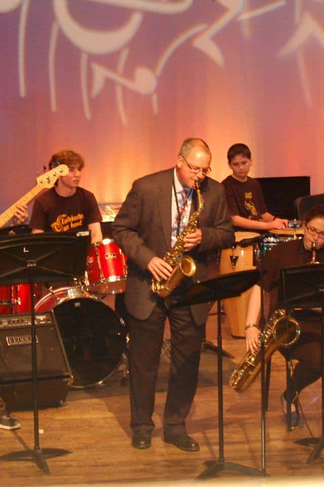 Eastchester Schools Superintendent Walter Moran performs with the Eastchester jazz band.