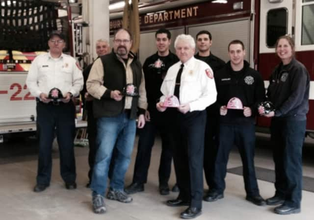 From left: Deputy Fire Chief Stephen Williams, Lt. Ken Appley, Tom Kelly, Firefighter Daniel Mansdorf, Chief Geoff Herald, Firefighters Adam Manawi, Joseph Capalbo and Lt. Heather Anderson.