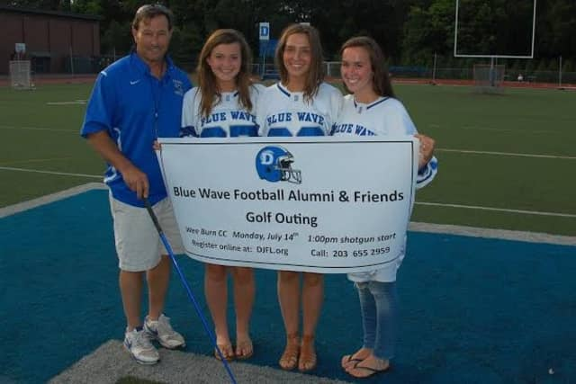 Darien football coach Rob Trifone, left, announces the first Darien Blue Wave Football Alumni and Friends golf outing along with managers (from left) Hannah Hickey, Jenny Goersch and Tyson Maley.