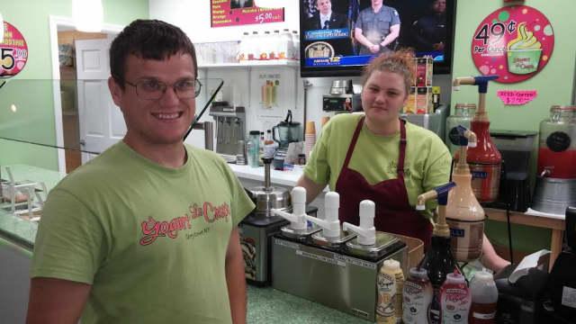 Andrew Kozak of Tarrytown, left, with co-worker Christanne Heffelfinger, is a valued member of the Yogurt La Crepe staff in the village.