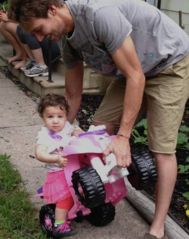 Keela Paige playing with her father, Rob, in Mount Vernon on Thursday afternoon.