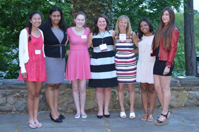 From left Kaitlin Cardon, Alisa Choubay, Claire Teahan, Julie King, Lauren Wyler Smith, Melissa Preudhomme, and Rachel Underweiser.   Not pictured - Morgan Rappe.