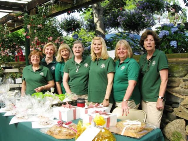 Pound Ridge Garden Club members prepare for the club's annual bake sale at Pound Ridge Nurseries on Saturday, June 21, from 8:30 a.m.-4:30 p.m.