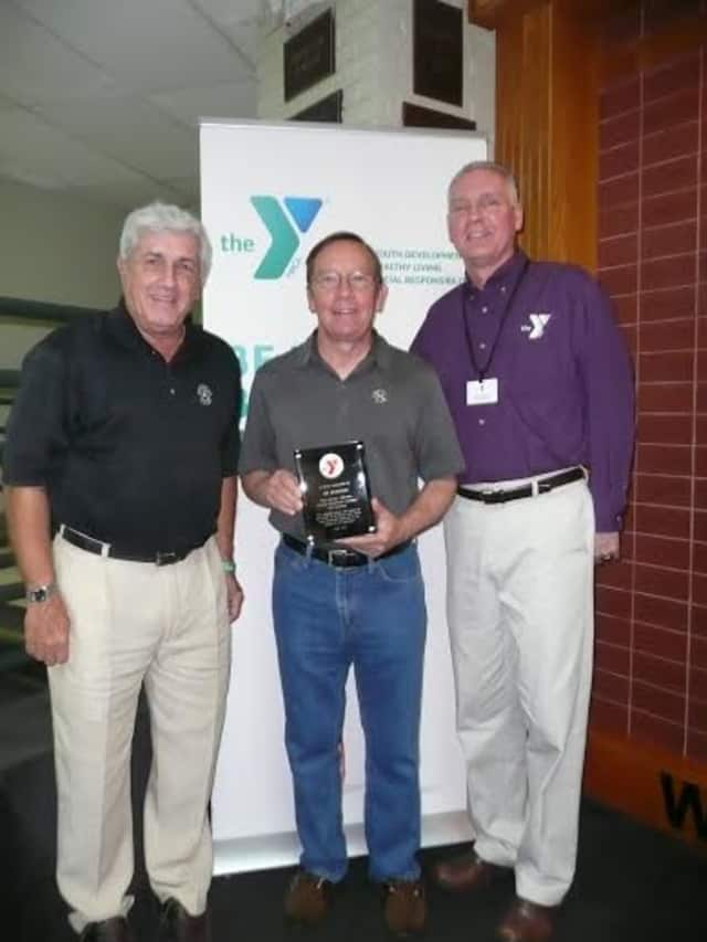 From left, in the lobby of the Wilton Family Y's lobby are Howard Steinberg, Jim Meinhold and Bob McDowell.