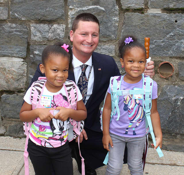 Elmsford Union Free School District Superintendent Joseph Ricca with two students on the opening day of school, September 2013.