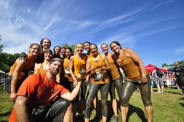"""Team Sherpa from Westport celebrates after completing the """"Down & Dirty"""" obstacle race in Hartford."""