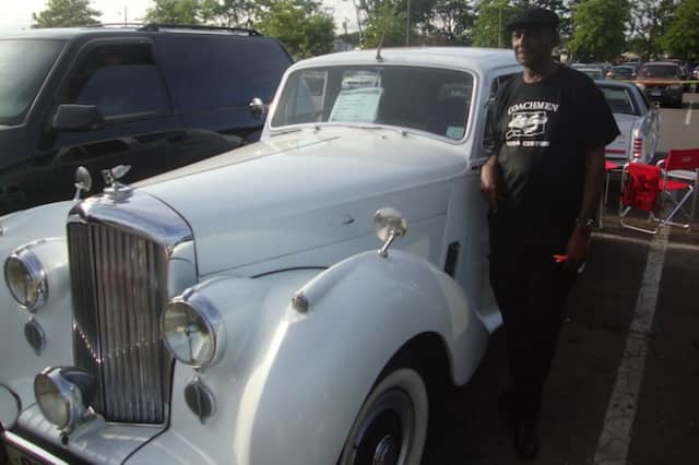 Verdi Richardson stands with his 1954 Bentley at a classic car show at Norwalk's Calf Pasture Beach.