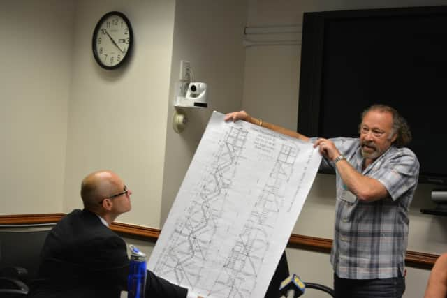Tom Cohn, right, presents a schematic at a Westchester County Board of Legislators' committee meeting.