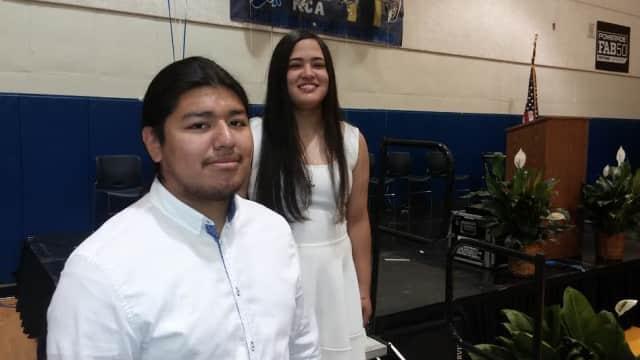 Clark Academy valedictorian Juergen Uraga, left, and salutatorian Mega Candelaria graduated Friday, June 27.