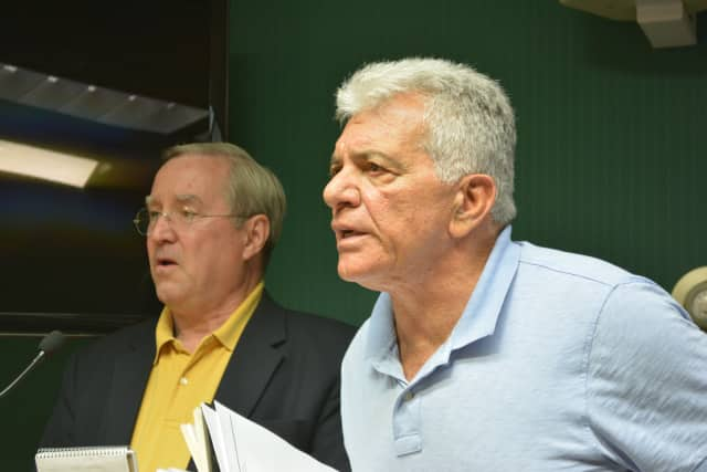 Armonk developer Michael Fareri, right, is reportedly changing his proposal for a development at an old lumberyard from a mix of 30 market-rate condos and six affordable units to a project with 48 affordable units.
