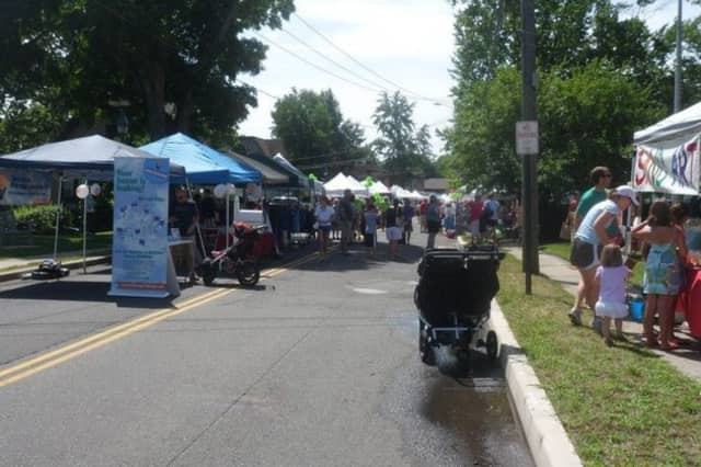 Local businesses, organizations and community members gather at the 2013 Wilton Street Fair and Sidewalk Sale.