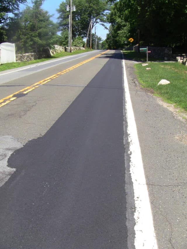High Ridge Road in Pound Ridge has only been partially re-paved.