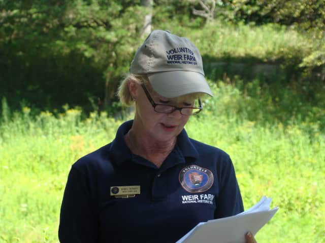 Volunteer Bonnie Tremante reads from Julian Alden Weir and Anna Baker's love letters. Tremante will host a Nature of Love walk at Weir Farm on Saturday, July 19.