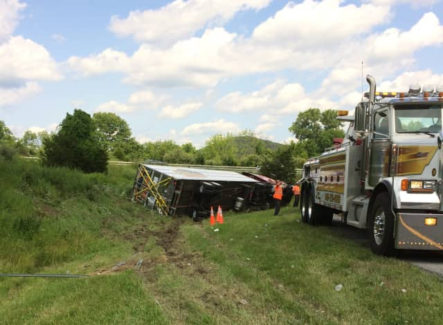 An overturned tractor trailer is about to be towed by Lisi's Towing Company early Monday afternoon near the I-684/I-84 interchange in Brewster, N.Y.