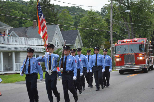 Patterson firefighters march in the 2014 Brewster fire parade.