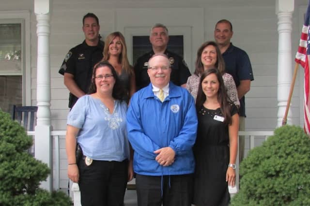 Back row: Sgt. Jeremiah Marron, Chief Duane Lovello, Det. Sam Boccuzzi. Middle row: Kristin Hocker of Maplewood Senior Living and Carrie Bernier of the Community Fund. Front: Det. Elizabeth Dilorio, Dennis Hanlon and Christine Fitzsimons of Maplewood