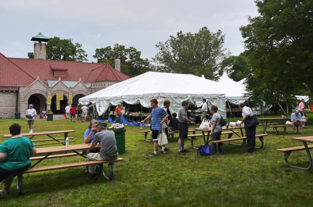 Hundreds turn out to the Pequot Library Annual Summer Book Sale in Fairfield to peruse one of the largest library book sales in the state.