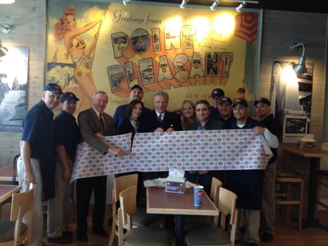 First Selectman William Brennan and former New York Yankee John Ellis are on hand to officially welcome Jersey Mike's to Wilton.
