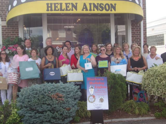 Members of the Darien Chamber of Commerce gather outside Helen Ainson to celebrate the upcoming sales tax-free shopping week, which begins Aug. 17.
