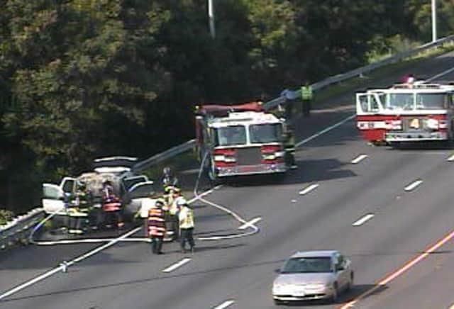 Firefighters battle a car fire on I-95 near New Creek Road in Westport.