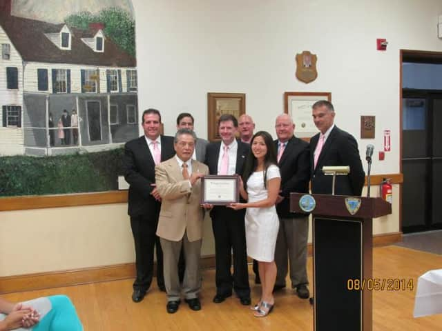 """The Village Board of Trustees and Elmsford Mayor Robert Williams present Johshin Honzan, left front, and his World Seido Karate dojo with a declaration making Aug. 6 """"World Seido Karate Day"""" in the village."""