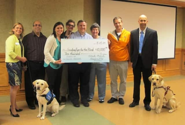 Guiding Eyes for the Blind received a $10,000 grant from Hitachi Metals America Ltd.'s local Community Action Committee. The grant will be used to fund the organization's Sights on College program, which provides guide dogs for students.