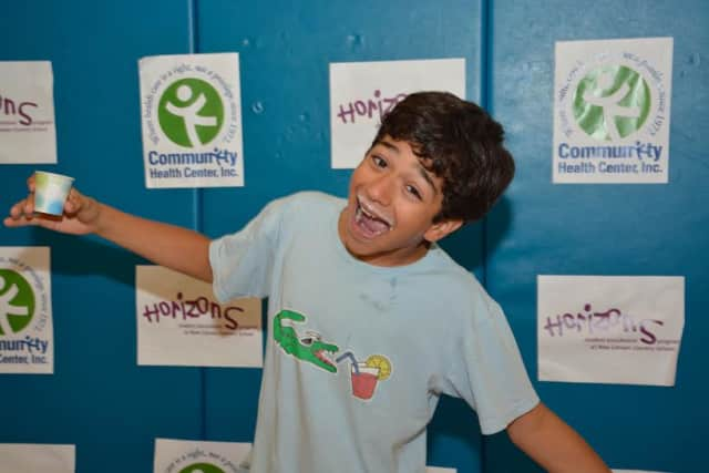 Horizons Summer Program eighth-grader Solomon Zapata of Norwalk takes part in the milk mustache photo booth at the CHC Health Fair held July 16 at New Canaan Country School.