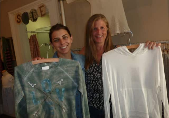 Lauren Mulligan, left, and Melissa Thompson, co-owners of the year-old clothing store Frock & Frill at 237 Danbury Road in Wilton. The business expects to see sales increase during the state's sales-tax break this week.