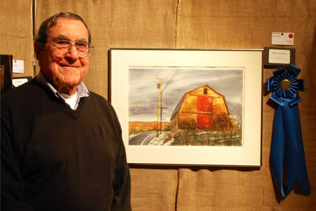 Stan Pastore with his watercolor painting, 'Old Yella,' which won Best in Show at the 56th Annual Darien Art Show and Sale at the Darien Arts Center.