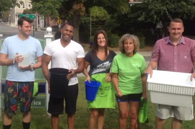 Better Homes and Gardens Rand Realty employees, left to right, Julian Diaz, Billy Ponce, Sandy Stemlach, Arlyne Ashkinos and Don Heithaus recently took part in the ALS Ice Bucket Challenge.