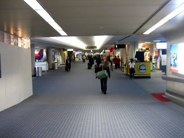 A Yonkers man is facing charges after he was accused of attacking a worker at LaGuardia Airport on Wednesday, Aug. 27.