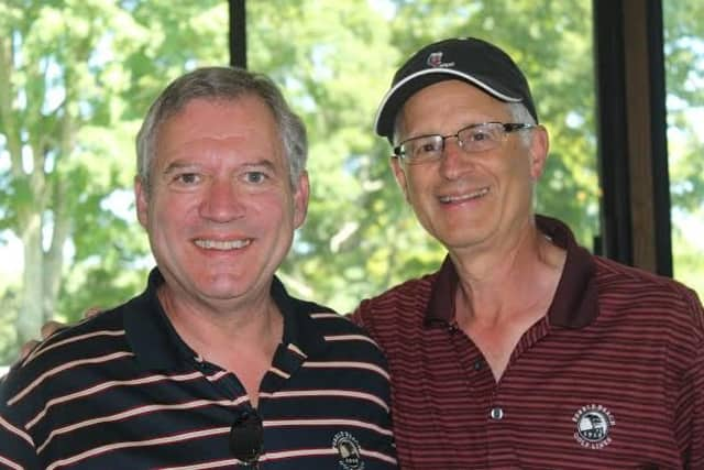 Mark Tonucci, left, and Michael Portnoy of Westport Resources were among a threesome that won a grant from Fairfield Community Foundation at a recent golf tournament. Along with Paul LaBossiere, they split the $5,000 grant among three charities.
