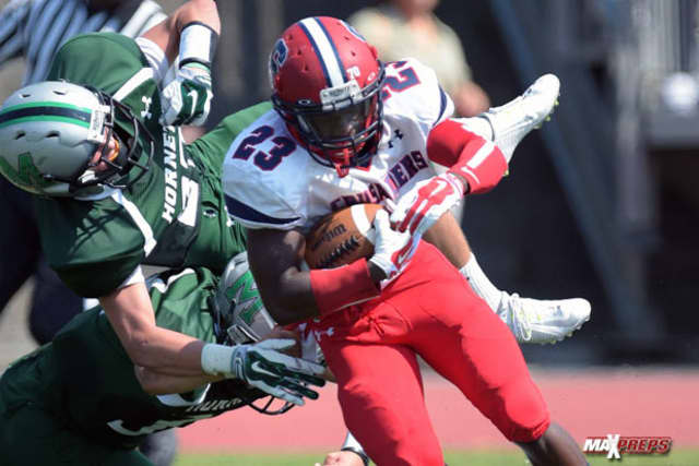 Archbishop Stepinac's Malcom Major runs for yardage in a  42-7 win over Mansfield. Major rushed for 113 yards in the 42-7 win.