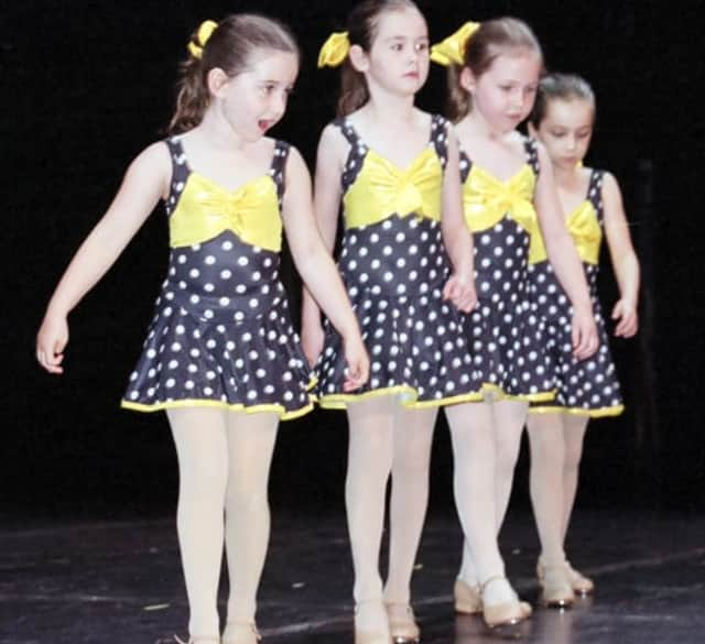 A quartet of young tap dancers perform at Dance Adventure's staged recital at Palace Theater: