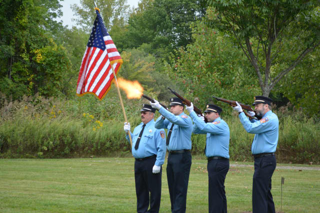 Pound Ridge firefighters, pictured performing a fusillade at a 9/11 service.