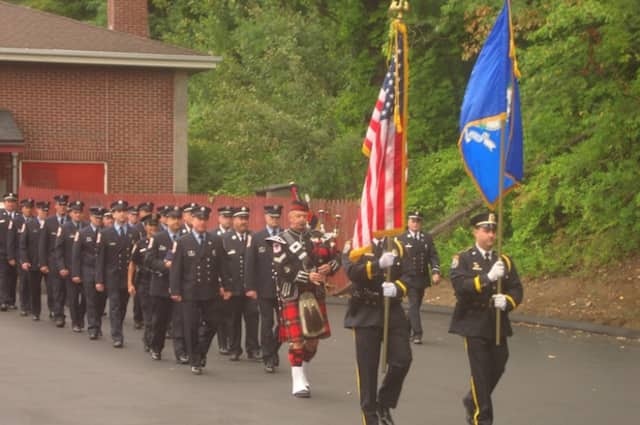 Wilton firefighters and police officers march in the tribute held in honor of those who died in the Sept. 11 attacks.