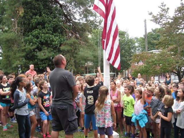 Students and faculty of Main Street School gather to reflect on 9/11.