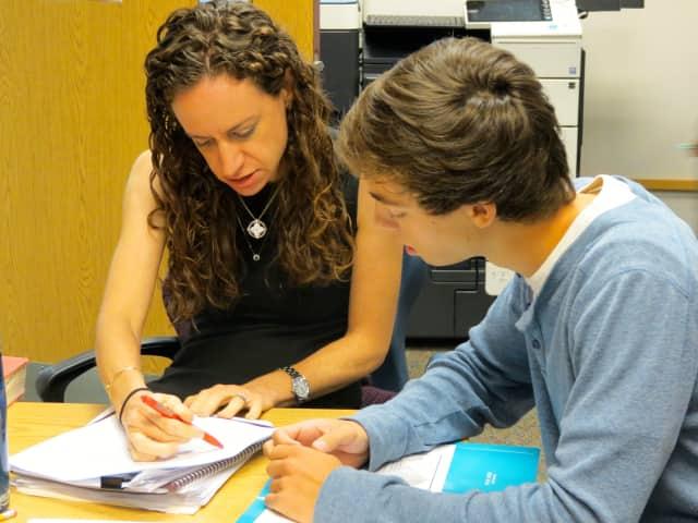 English teacher Samantha Fishman works with Briarcliff High School senior David Kaminsky on a college essay in the school's writing lab.