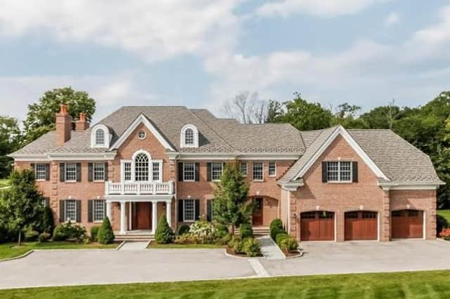The estate of award-winning New York banker Jared Samos,  adjacent to the Winged Foot Golf Club in Mamaroneck, is being listed by Julia B. Fee Sotheby's International Realty.