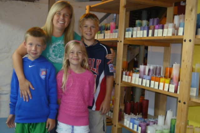 Jenn Heatly of Norwalk, with her children (from left) Pace, 9; Bell, 7; and Landon, 11, runs a candle-making business of her home.