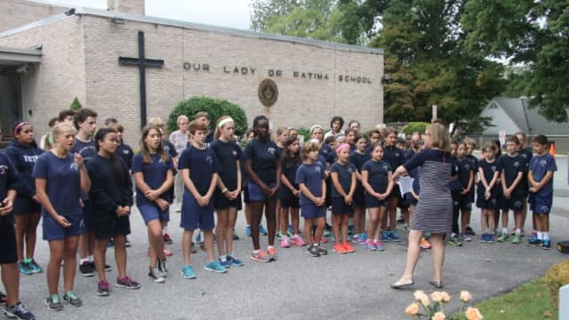 Students gather at the Our Lady of Fatima School's 9/11 Memorial Service. There will be an Open House next weekend for prospective students and their families.