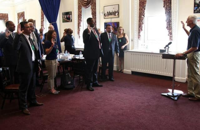 Mount Vernon Superintendent Kenneth Hamilton being sworn in at the White House.